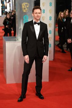 Pin for Later: See All The Fashion at the 2015 BAFTA Awards Tom Hiddleston Tom had us swooning in a classic black tuxedo.