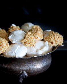 Meringues dipped in white chocolate and almonds