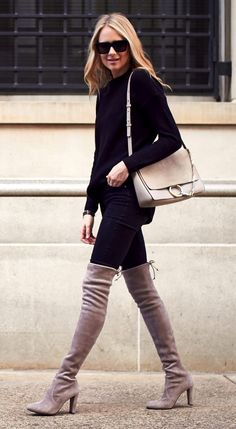 Amy Jackson has created a glamorous fall style here, totally owning the vibrant contrast of the beige boots and otherwise black outfit. Wear a coloured pair of thigh high boots with an understated all black style to get this awesome look.    Sweater/Trousers: Nordstrom, Boots: Stuart Weitzman, Handbag: Chloe.