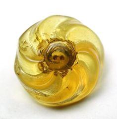 Antique Charmstring Glass Button Honey Pinwheel Flower Mold, Swirl Back. Measures 9/16 inch. Circa 1840-1860.