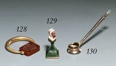 A gold and cornelian Hand-seal in the Scythian style by Fabergé, workmaster Erik Kollin, St. Petersburg, circa 1890, with scratched inventory number 50037 Shaped circular, the partly ribbed tapering ring holding the swivel hardstone matrix, one side engraved with a coat of arms, the other with an open lock and the date '20 March 1895',marked on mount 2.1/8in. (5.4cm.) wide