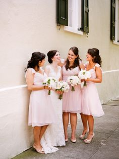 Love the Bridemaids gowns in the soft pink tea length dress.
