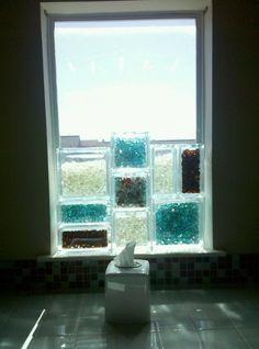 glass bricks with glass beads-this is a fantastic idea to use on my window in my shower!  I love it