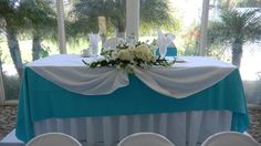 Tiffany blue turquoise bride and groom sweetheart wedding table with flower centerpiece.