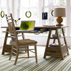 Office with green stripe rug and oatmeal desk