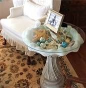 Use a birdbath as table - filled with special things you can see through glass! Love