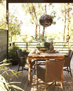 CALIFORNIA STYLE WITH AN ASIAN TWIST    On the deck, wicker chairs surround an antique Chinese table, and the brass lantern is also Chinese.
