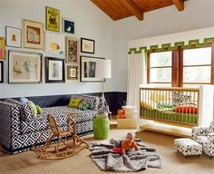 An Eclectic Mix:     This gallery wall includes everything from a yellow Beatles poster to a dark frog painting, from an oversize gold frame to an understated white canvas. Still, the gallery works well in the space because of the frames' balanced arrangement and consistent colors. Bold shades and patterns throughout the rest of the nursery make the room's design feel purposeful and coordinated.