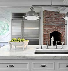 Exposed brick oven and carrara marble in kitchen; Granoff Architects