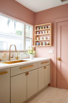 Beautiful remodeled kitchen with pastel green color cabinets, brass fixtures, and pink colored walls Pink Kitchen Walls, Pink Kitchen Cabinets, Green Cabinets, Kitchen Cabinet Colors, Kitchen Colors, Pink Walls, Pink Kitchens, Kitchen Black, Cottage Kitchens
