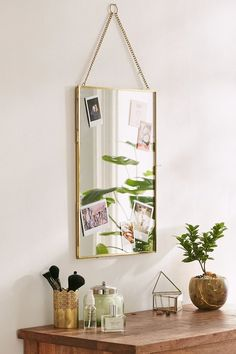 Mirror Frame.   Simple mirror that opens to double as a frame for photos, flowers + more!   #decor #minimalism