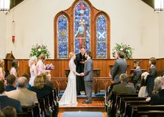 Love this photo of such a beautiful couple inside of the church during to the Fox/Blackwelder Wedding! Photo Credit: Emma Loo Photography