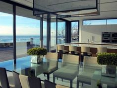 Modern Dinning Room from Luxury Ocean House with Amazing Garden and Swimming Pool Ideas 600x450 Luxury Ocean House with Amazing Garden and Swimming Pool Ideas