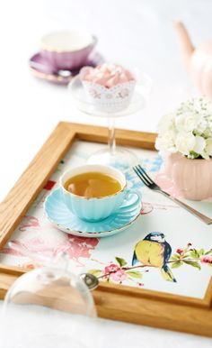 Create your own tea tray using a photo frame and wallpaper sample