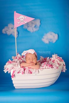 Totally making a pennant for my boat and putting clouds on my blue back drop! Now I need a baby.