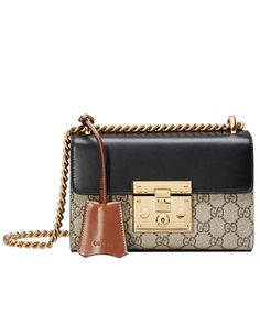 A small structured GG Supreme canvas bag with a leather top and our key lock closure. The sliding chain strap can be worn multiple ways, changing between a shoulder and a top handle bag. Gucci Padlock, Popular Purses, Key Lock, Supreme, Handle, Shoulder Bag, Closure, Chain, Canvas