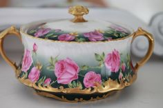 Exquisite antique French Limoges porcelain biscuit jar with pink roses.
