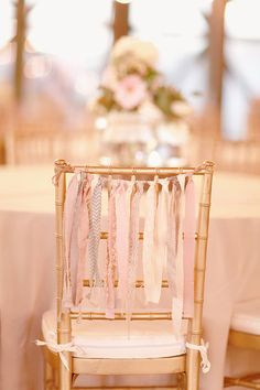 gold chairs with ribbons http://www.weddingchicks.com/2013/10/11/alabama-wedding/