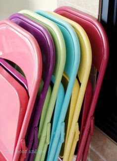 Spray paint your dull chairs for a cheap and easy  face lift.  We ALWAYS need folding chairs for our get togethers.  I am totally buying some at thrift stores and spray painting them.