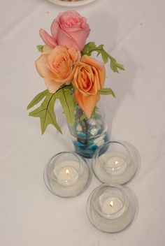 centerpiece view from the top: peach roses, pink roses and fresh oak leaves