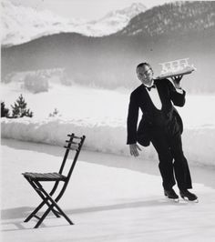 Alfred Eisenstaedt, Headwaiter Renée Breguet of Grand Hotel St. Moritz serving cocktails on ice rink, 1932