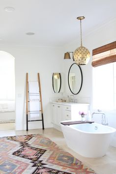 Dreamy bathroom space: Photography : Becki Owens Read More on SMP: http://www.stylemepretty.com/living/2016/06/30/all-you-need-in-this-dream-bathroom-is-a-glass-of-wine/