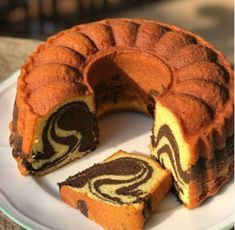 Image may contain: food Marble Cake Recipes, Pumpkin Cake Recipes, Dessert Recipes, Marbel Cake, Bolu Cake, Chocolate Marble Cake, Cake Oven, Resep Cake, Traditional Cakes
