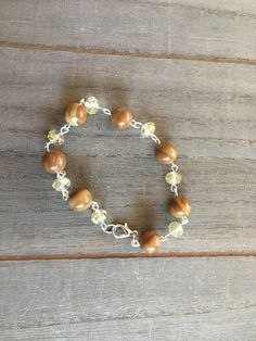 """Brown wood jasper bead semiprecious stone bracelet with gold / yellow faceted czech glass beads on silver eye pins 8"""" long by GingerBlossomJewelry on Etsy https://www.etsy.com/listing/527078788/brown-wood-jasper-bead-semiprecious"""