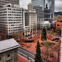 Pioneer Square from The Nines. Here's the outdoor arena where Riley takes Emma to see the play Michael's in. I'm lovin' the bricks. State Of Oregon, Oregon Usa, Portland Architecture, Downtown Portland Oregon, Voodoo Donuts, Oregon Living, Oregon Travel, November 2013, Tree Lighting