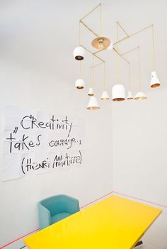 Latvian designer Anna Butele used fluorescent paint and marker pens to write inspirational messages across the walls at the new office of her interior design firm Annvil in Riga (+ slideshow).