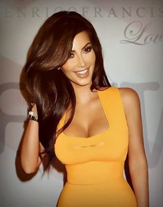 Kim looks amazing in this shot - beautiful hair and make-up. That yellow dress is just divine on her! Beauty inspiration for sure x