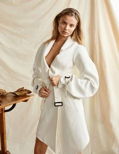 Model Magdalena Frackowiak poses in white trench coat from Burberry