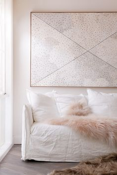 Icelandic Sheepskin throw and rug with White linen sofa cover, by Society of Wanderers.