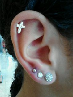 gonna get the top of my ear re peirced and I want this cross when I get it done.
