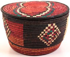 Africa   Coiled stitched baskets woven by the Nubian women in Darfur, Sudan   Papyrus stalks inside the coils and palm leaf on the outside;  the palm leaves give a sheen to the surface of the baskets.