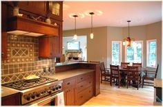 "Another view if this beautiful craftsman style kitchen with Old California ""Live Oaks"" fixtures in the background"