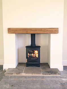 small wood burning stove with wood mantle...