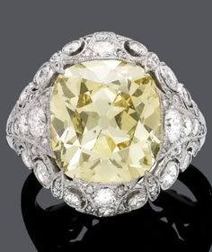 A FANCY COLOURED DIAMOND AND PLATINUM RING, BY A. TILLANDER, Finland, circa 1937. Centring one cushion-shaped intense yellow diamond weighing 7.70 carats, and further set with brilliant- and circular-cut diamonds, mounted in platinum. Signed A. Tillander. #Tillander #ArtDeco #ring