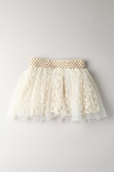 adorable baby skirt--looks like a baby girls skirt made from one of those stretchy crocheted headbands, crochet lace, and a layer or tulle or nylon chiffon. Was a daily deal, so no current link.