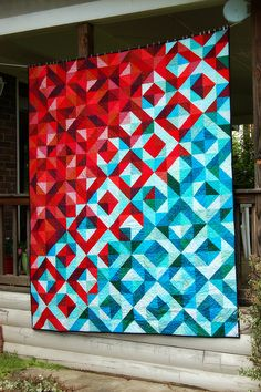 This is beautiful!  Lava Meets Sea half square triangle quilt Tutorial.  I love this quilt!