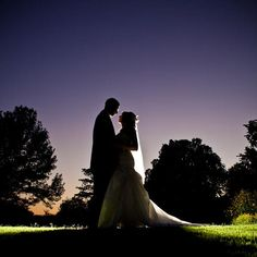 """Why We Love It:  Sneak outside for a portrait after sundown—the lighting is gorgeous!Why You Love It:""""Sundown are perfect for love pictures."""" —Deanna P. """"True love..... Feel the happiness."""" —Cindy D.  """"Always love sundowns!""""—Annabel L.Photo Credit: Matt Andrews Photography"""