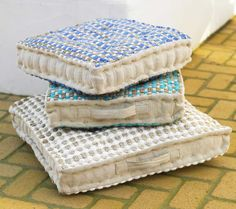 Great for additional seating, especially around a coffee table.  Soothing seaside colors.