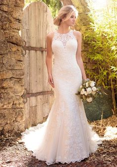 Each detail of this Essense of Australia Lavish satin wedding gown is meticulously designed to give you the gown of your dreams. The halter neckline and back feature gorgeous illusion lace detailing in your choice of ivory or white. The back zips up with ease under fabric-covered buttons.
