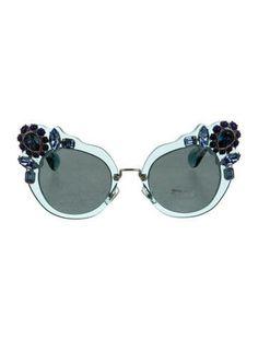 40e237386cb3 Aqua resin Miu Miu sunglasses with crystal embellishments at frame and  tinted lenses. Includes case