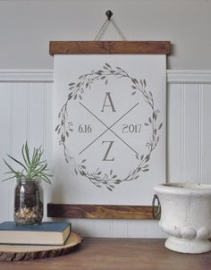 Custom canvas print. The art work features a wreath with initials and est. date. Please leave desired name and date in note to shop when ordering.  Three options- Canvas print framed with wood as pictured or PRINT ONLY. Print only sizes- 8.5 x 11 inches 13x19 inches 17x22 inches  Finished poster frames, pictured first Sizes- Medium- 9.5 x 13 inches Large- 14 x 21 inches Extra Large- 18 x 23 inches  Finished box frame sizes- 10x13 inches 15x21 inches  Made with professional canvas sheets and…