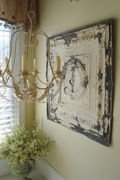 Antique ceiling tiles- might be the answer for the porch wall decor I am looking for.