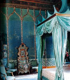The master bedroom at the Palazzo Brandolini, eighteenth century decor, Chinese wallpaper.   The bed is an original construction, blue taffeta and lined in Indian silk gauze.