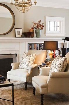 Jennifer Worts Design transitional living room design with gorgeous rolled arm chairs with classic turned legs, floral pillows, fireplace, round bl. My Living Room, Home And Living, Living Room Furniture, Living Room Decor, Living Spaces, Cozy Living, Small Living, Bedroom Decor, Estilo Craftsman