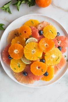 Citrus Fruit Salad is a delicious medley of juicy, tart winter fruits including grapefruit, tangerines, and clementines, and garnished with fresh mint and sweet blueberries. Fruit Dishes, Fruit Salads, Avocado Salads, Fruit Recipes, Recipies, Salad Recipes, Healthy Recipes, Fresh Fruit, Fresh Mint