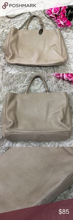 """Vintage Furla Leather Tote/Handbag Authentic vintage Furla taupe toe / handbag with handles in addition to removable Crossbody strap. Silver Furla charm hangs from handle. Drop strap is roughly 41"""" in length. Bag is slightly worn on outside, but no serious stains. On the inside at the top there is a small pen mark that is displayed in photos. Inside of bag has two compartments separated by a zipper middle compartment and one zip side pocket. 14"""" across; 10"""" in height; and almost 11"""" deep…"""